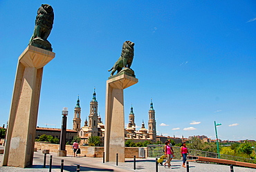 Sculptures of lions, which are located on both extremes of the Puente de Piedra Zaragoza, Aragon, Spain, Europe