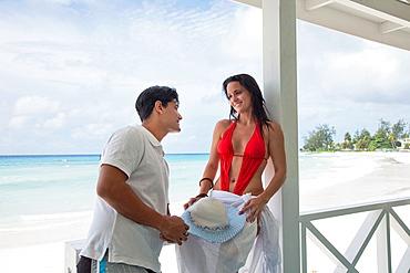 Caribbean Barbados Couple on a deserted beach.