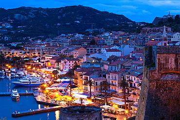 France, Corsica, Haute-Corse Department, La Balagne Region, Calvi, elevated view of the Port de Plaisance port, dusk