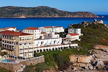 France, Corsica, Haute-Corse Department, La Balagne Region, Calvi, Punta San Francisco point, elevated view of coast hotels, morning