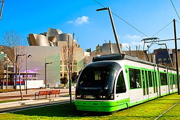 Tram and Gugenheim Museum. Abandoibarra avenue. Bilbao. Bizkaia. Vizcaya. Pais Vasco. Euskadi. Basque Country, Spain