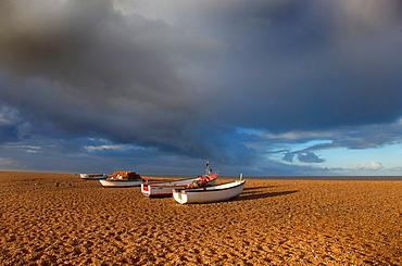 Boats on Cley Beach UK Novemberr storm