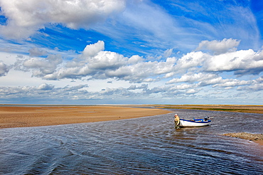 Mussels fisherman returning on river Stffkey in Blakeney Harbour Norfolk September