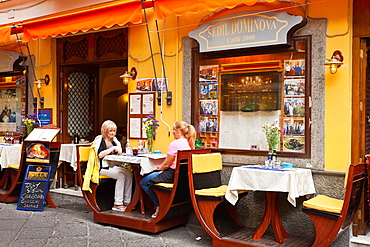 Tables and chairs at an outdoor restaurant in Sorrento, Campania, Italy