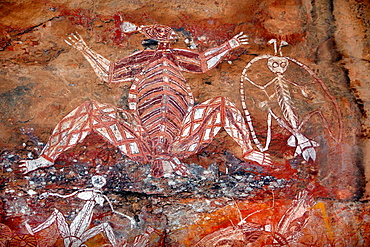 Aboriginal rock art depicting Creation ancestors Namondjok rigth, and Namarrgon leftat Anbangbang shelter Nourlangie Rock in Kakadu National Park, Northern Territory, Australia