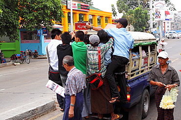 Downtown street scene, shops, people, traffic, Yangon Rangoon, Myanmar, Burmaa, Asia