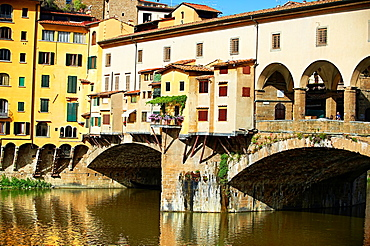 The medieval The Ponte Vecchio 'Old Bridge' crossing the River Arno in the hiostoric centre of Florence, Italy, UNESCO World Heritage Site