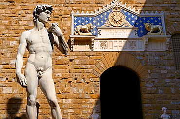 Renaissance sculpture created between 1501 and 1504, by the Italian artist Michelangelo In front of the Palazzo Vecchio, Piazza della Signoria in Florence, Italy,