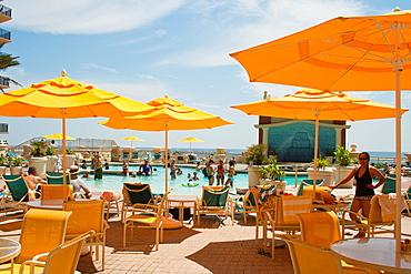 swimming pool area of the Emerald Grand Hotell, harbor Village in Destin Florida US