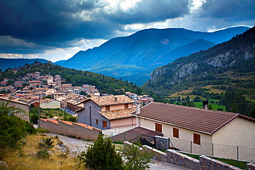 Spain, Catalonia, Pyrenees, Gosol A storm brews above the village of Gosol in the Catalonian Pyrenees mountains