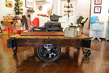 A coffee table crafted from rail wheels and boards at the Atlantic Workshop, Cape Cod, Massachusetts
