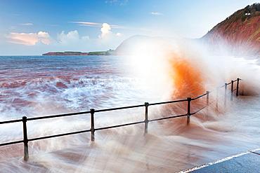 Waves crashing against walkway in Sidmouth, Devon, England, United Kingdom, Europe