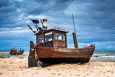 Two Fishing boats at the beach of the Baltic Sea, near the pier of the Baltic Sea resort of Ahlbeck, Municipality of Heringsdorf, Usedom Island, County Vorpommern-Greifswald, Mecklenburg-Western Pomerania, Germany, Europe