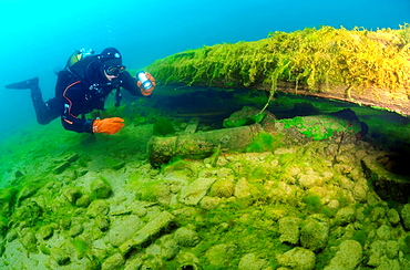diver examines an ancient gun found under water Lake Baikal, Siberia, the Russian Federation, Eurasia