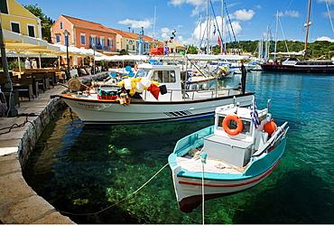 Island of Kefalonia Cephalonia, Greece: Fiskardo waterfront, fishing and pleasure boats, restaurants, houses, Fiskardo Bay