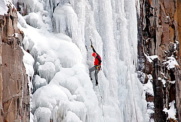 Mark Weber ice climbing Palisade Falls which is rated WI-4 and located in Hyalite Canyon in the Gallatin Mountains near the city of Bozeman in southern Montana