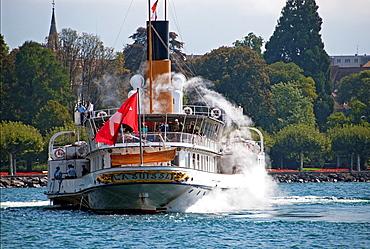 Swiss historic steamboat cruise, Lake Geneva, Lac Leman, Swiss Riviera, Switzerland, cityscape of town Vevey in the background