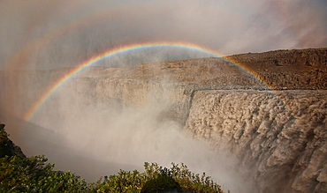 Rainbow over the amazing Dettifoss waterfall in Vatnajokull National Park, Iceland