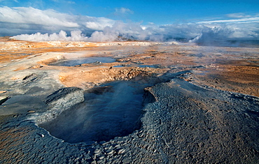 smoking fumaroles at the geothermal area of Hverir near Lake Myvatn, Iceland