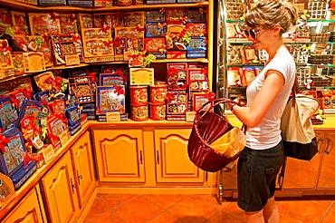 young woman in chocolateria in Marseille, France