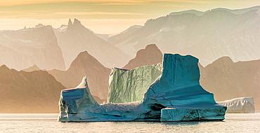 Sunset over Icebergs Icebergs drifting in Scoresbysund, Sermersooq Municipality, Greenland