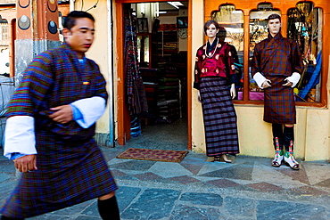 Bhutanese man with traditional dress walking in the center town, Thimphu, Bhutan, Asia.