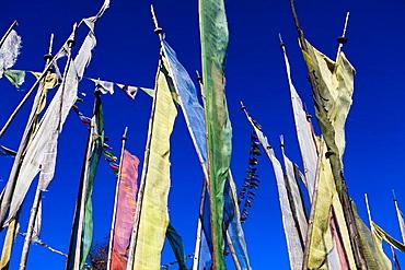 Prayer flags in the top of a mountain in central Bhutan, Trongsa, Bhutan, Asia.