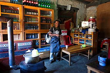Local man in a general store, Trongsa Town, Bhutan, Asia.