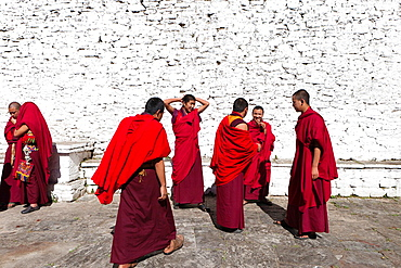 A group of monks in the patio of Trongsa Dzong, Trongsa, Bhutan, Asia.