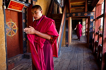 Monks inside Trongsa Dzong, Trongsa, Bhutan, Asia.