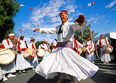 Argelian musician and dancer International Festival of the Sahara Douz Southern Tunisia.