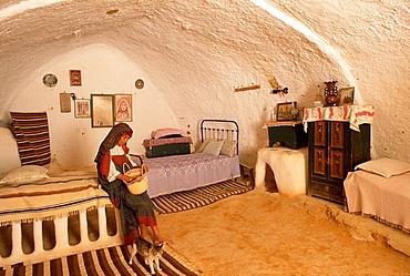 Fatima inside a cave house Matmata Southern Tunisia.