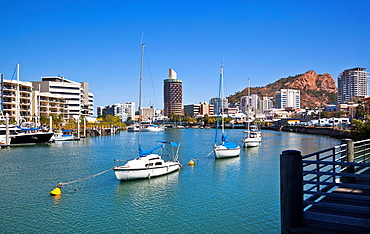 Australia, Queensland, Townsville, view of Ross Creek and the Townsville CBD with Castle Hill and the distinctive Holiday Inn building, nicknamed the 'Sugar Shaker'