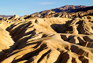 Eroded badlands at Gower Gulch seen from Zabriskie Point in the last light of the evening Death Valley National Park, California, USA