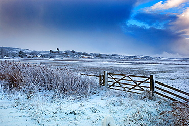 Salthouse village and grazing marshes Norfolk in Winter snow