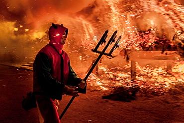 Correfoc', typical catalan celebration in which devils armed with fireworks dance through the streets. San Antonio festival, Villafranca del Cid, Castellon, Castellon province, Spain†