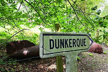 France, Nord-Pas de Calais Region, Pas de Calais Department, Eperlecques, Le Blockhaus de Eperlecques, World War Two German V2 rocket bunker, bombs and road sign for Dunkerque