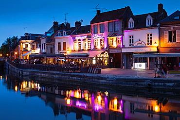 France, Picardy Region, Somme Department, Amiens, Quartier St-Leu, restaurants along the Somme River, dusk