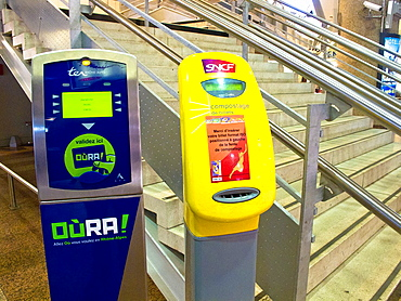 Machines to verify the ticket. Lyon, France.