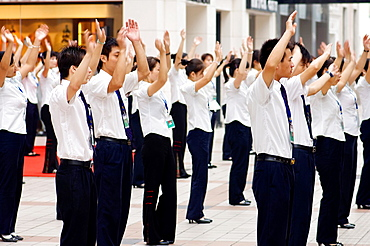 A department store workers perform exercises before starting their workday Beijing, China