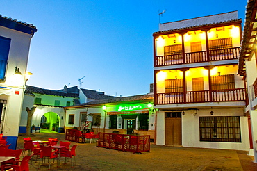 Small square, night view. Puerto Lapice, Ciudad Real province, Castilla La Mancha, Spain.