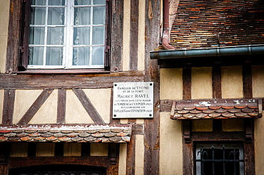 Historic half timbered building in rue d'Enfer in the pretty market town of Lyons la Foret in Haute Normandie, France There is a plaque on the wall of the house commemorating the fact that the French composer Maurice Ravel lived and composed there