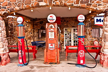 Cool Springs, AZ, USA, December 30, 2012, Old time gas pumps outside a restored service station on old Route 66 in Arizona are reminders of the early days of American auto travel Photo taken Dec 30, 2012