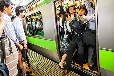 Rush hour at JR Shinjuku Railway station Yamanote Line Shinjuku, Tokyo, Japan