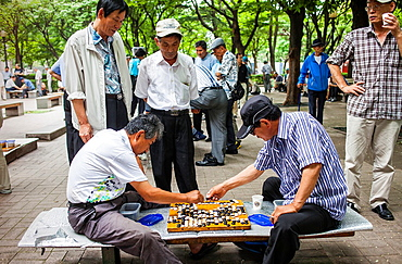 Men playing Baduk at Jongmyo park, Seoul, South Korea
