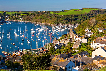 View over rooftops to boats moored in the Fowey Estuary from Polruan