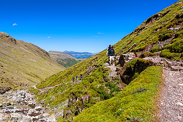 Walkers walking along path to Scafell Pike in the Lake District National Park, Cumbria, England, UK, Europe