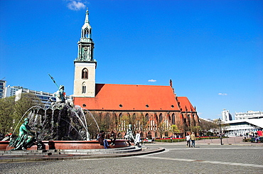 St -Marien-Kirche and Neptune Fountains at Alexanderplatz Berlin, Germany