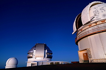 Hawaii-Canada-France, Gemini and UH 2 2 Telescopes from Mauna Kea Volcano Summit at Sunset, Big Island, Hawaii, USA