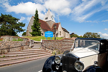 Vintage wedding car waiting outside St Margarets Church in Ditchling, Sussex
